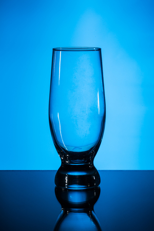 pint: A Tulip Shaped Pint Glass on blue background