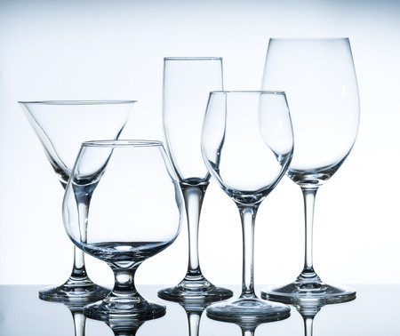 empty wine glasses on the glass table and white background