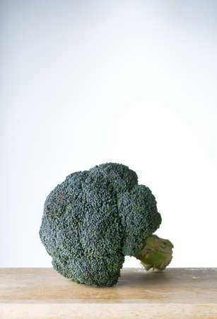 unwashed: fresh broccoli on wooden board Stock Photo