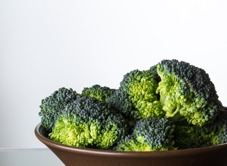 close up image: close up image of broccoli in brown bowl Stock Photo