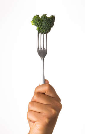 unwashed: broccoli on fork isolated on white background