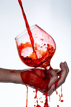 clean blood: pouring red wine into a wine glass Stock Photo