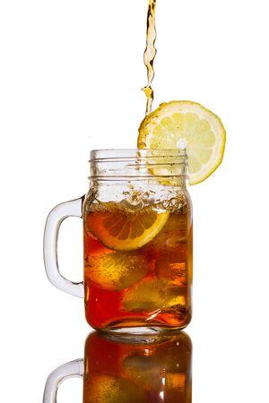 lemon: pouring lemon ice tea into a jar Stock Photo