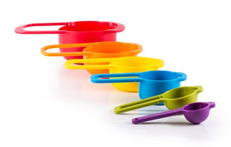 measuring spoons: colorful measuring spoons isolated on white