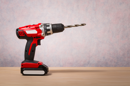 torque: Screwdriver, Cordless Drill on wood table