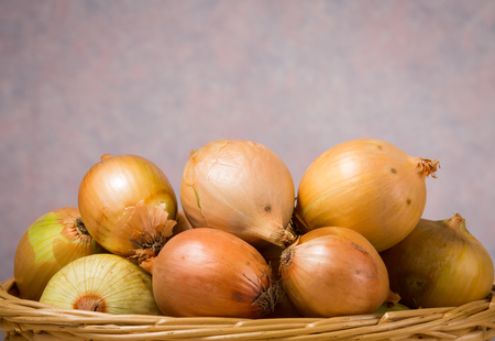 close up of onions in a basket: close up image of onions in basket
