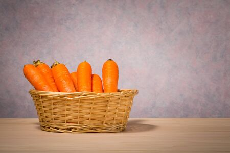 carrot: basket of carrots on wooden table