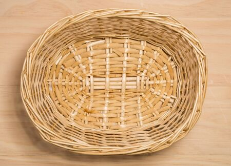 basket: Wicker basket on wooden background
