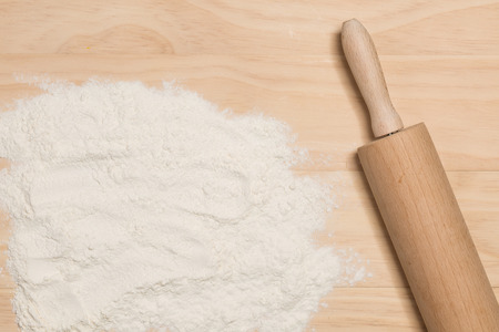 flour and rolling pin on wooden background Stock Photo