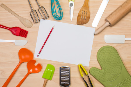 colorful kitchen utensils with blank paper and pencil on wooden background Stok Fotoğraf - 48133743