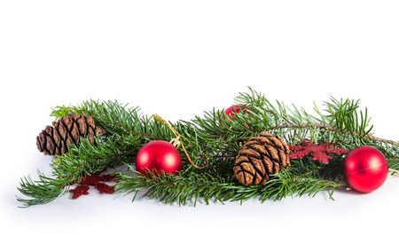 decoration objects: Pine cones and needles with christmas decoration isolated on white