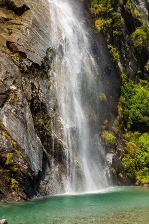 aspiring: beautiful waterfall in Mount Aspiring National Park in New Zealand