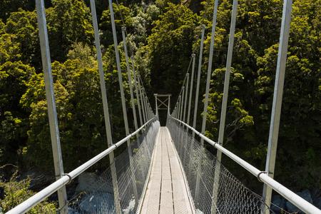 rob: Suspended bridge over Rob Roy stream in New Zealand