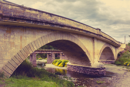 oamaru: historical Otepopo Bridge in North Otago Region, New Zealand with Vintage filter style