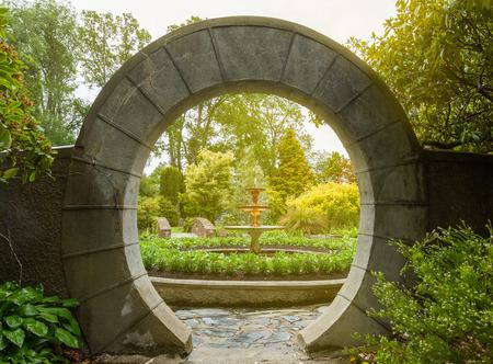 archway: Stone archway in flower garden