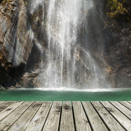 turquoise water: wooden pier with waterfall background