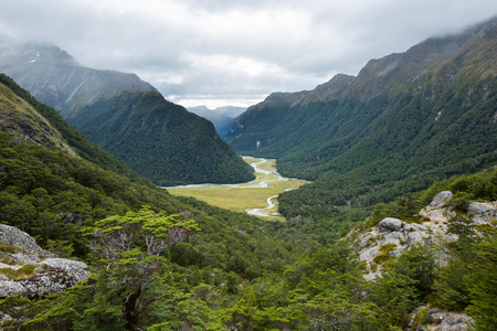 overlook view of Routeburn Valley from above Routeburn Falls in a cloudy day, New Zealand Stok Fotoğraf - 53551174