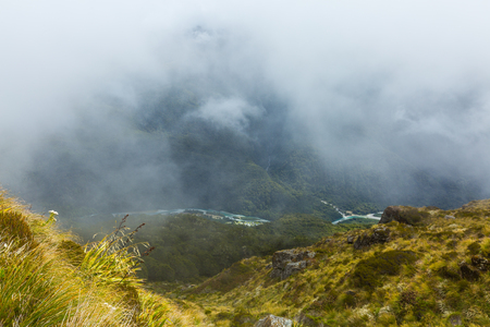 south island new zealand: View of Routeburn Track in a foggy day in South Island, New Zealand Stock Photo