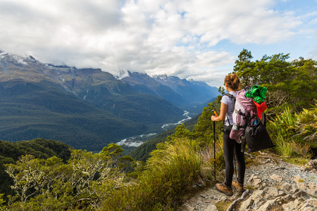 fiordland: Woman hiker looking at the view of Routeburn Track in South Island, New Zealand