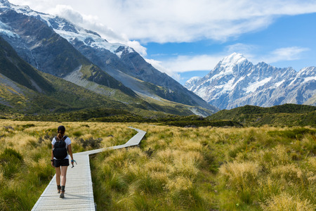 Woman hiker hiking on Hooker Valley Track in New Zealand