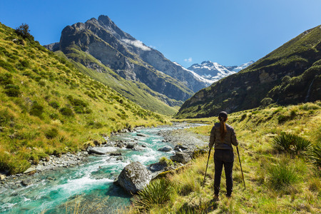 Woman hiker enjoys the view of Earnslaw Burn Track in Glenorchy, New Zealand