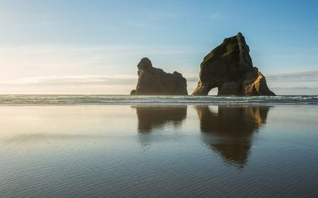 aotearoa: Rocky Islands at Wharariki Beach in New Zealand