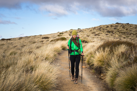 kepler: Woman hiker walking on Kepler Track, one of the New Zealand Great Walks Stock Photo