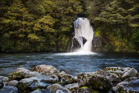 anau: Iris Burn Waterfall on Kepler Track. Kepler Track is one of the New Zealand Great Walks