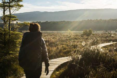 te: woman hiking at kepler track in Te Anau, New Zealand Stock Photo