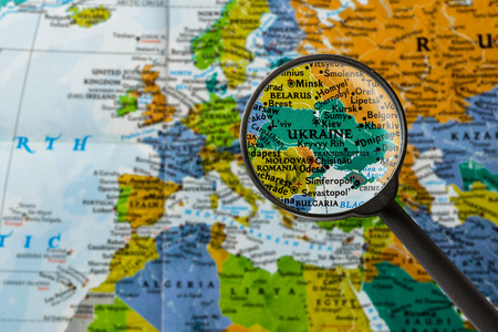 map of Ukraine through magnifying glass
