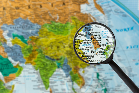 Map of South Korea through magnifying glass Stock Photo - 57265838