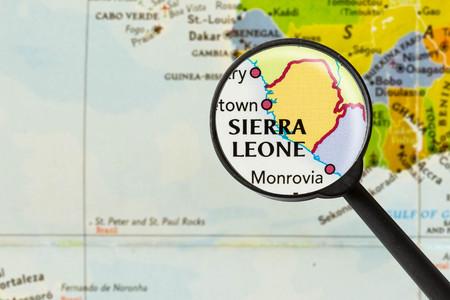 sierra leone: Map of Republic of Sierra Leone through magnigying glass Stock Photo