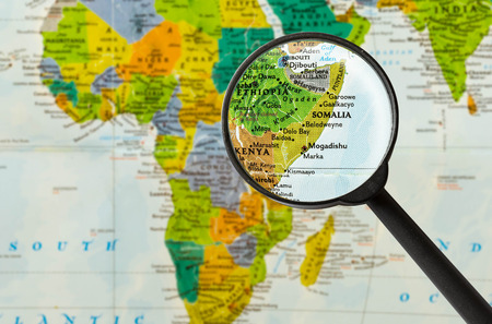Map of Federal Republic of Somalia through magnigying glass Stock Photo