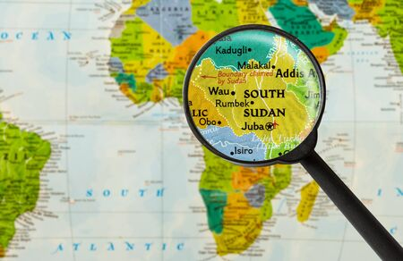northeastern: Map of Republic of South Sudan through magnigying glass Stock Photo