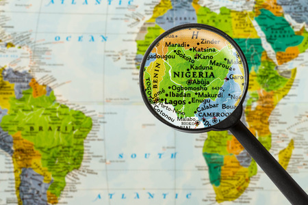 Map of Federal Republic of Nigeria through magnigying glass
