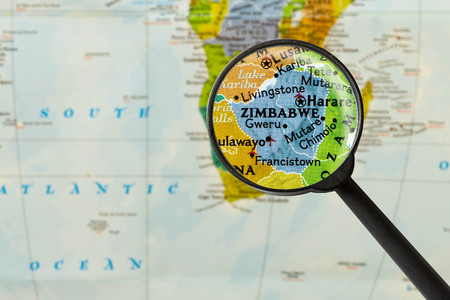 Map of Republic of Zimbabwe through magnigying glass Stock Photo