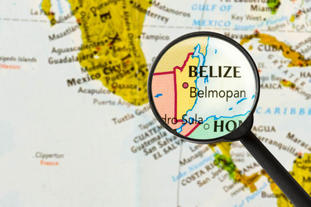 tourism in belize: map of Belize through magnifying glass Stock Photo