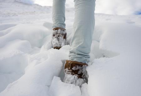 coronet: woman is walking in snow at Coronet Peak Stock Photo