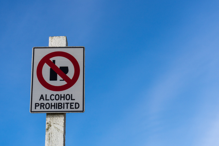 intoxicating: Alcohol prohibited sign and blue sky background