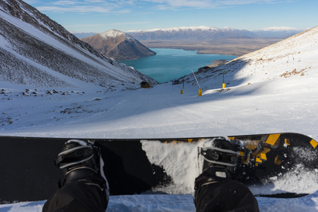 Snowboarder sitting and relaxing Stok Fotoğraf - 68447515