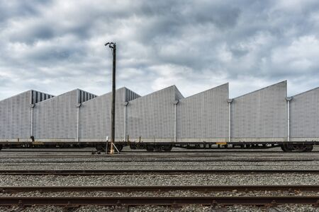 Industial background with railway, metalic building and dramatic sky