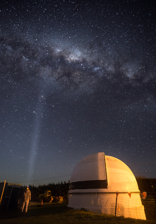 Woman standing next to an old observatory under the Milky Way Stok Fotoğraf - 68487897