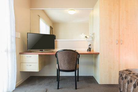 Working desk design with television and large mirror Stok Fotoğraf