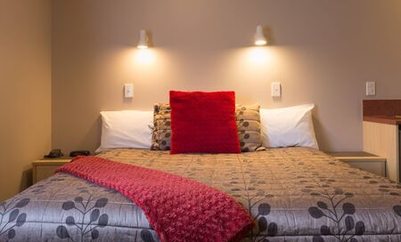 stylish bedroom interior design with red velvet and brown bed cover Stok Fotoğraf - 68490134