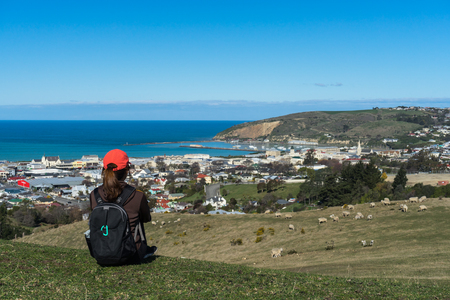 Woman tourist enjoys view of Oamaru in New Zealand Stok Fotoğraf - 68742743