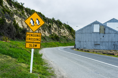 Penguins crossing traffic sign in Oamaru, New Zealand Stok Fotoğraf - 68569019