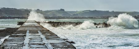 Waves crash on a breakwater during storm Stok Fotoğraf