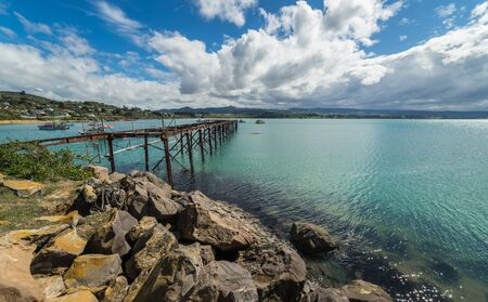 Old jetty in Moeraki, New Zealand Standard-Bild
