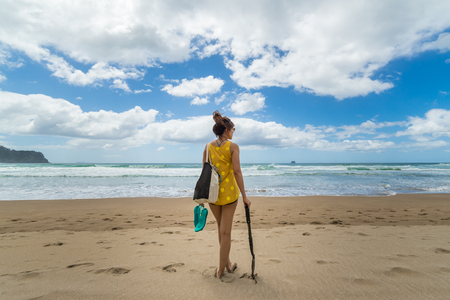 Woman with shovel at Hot Water Beach, Coromandel Peninsula, New Zealand