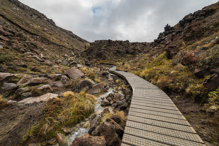 Wooden boardwalk in Tongariro national park, New Zealand